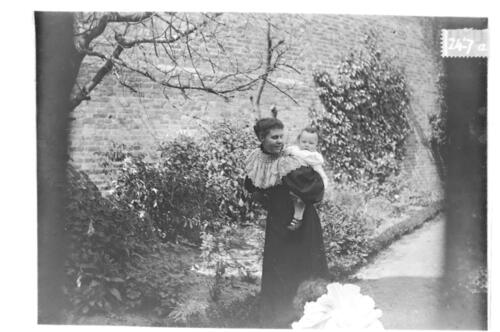 J.H.M (Jane Miller) and Fred (Miller) [in the garden Cleveland Cottage, Isleworth].