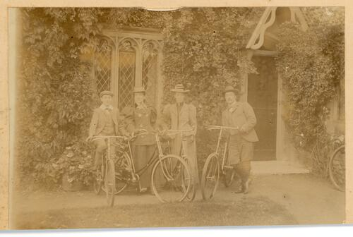 Four bicyclists ready to set off.