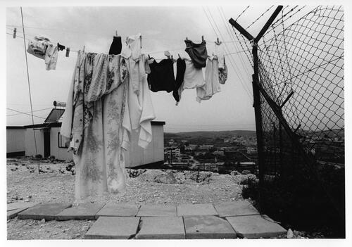 [Laundry is drying outside, next to prefabricated buildings]