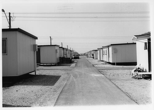 [A street lined up with prefabricated buildings]
