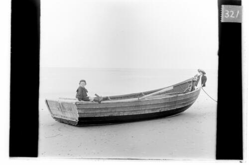 Fred and Ida [Miller on a boat at Findhorn].