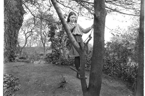 Ida [Miller, on the swing, in the garden of Cleveland Cottage, Isleworth.]