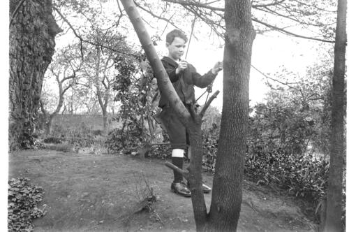 Fred [Miller, on the swing, in the garden of Cleveland Cottage, Isleworth.]