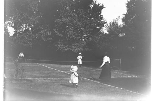 The Millers [playing tennis in the garden at Cleveland Cottage, Isleworth].