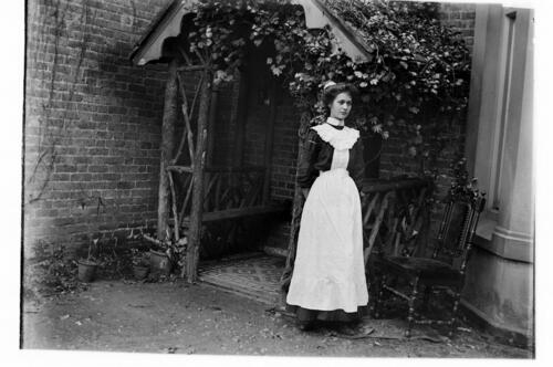 [Housemaid in the garden at Cleveland Cottage, Isleworth].