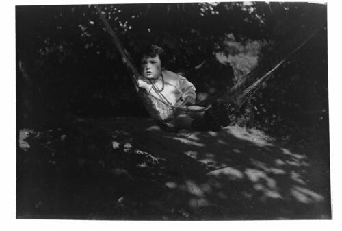 Austin [Miller in a hammock in the garden at Cleveland Cottage, Isleworth].
