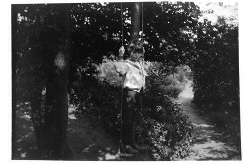 William [Miller on the swing in the garden at Cleveland Cottage, Isleworth].