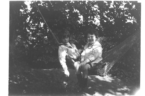William and Austin [Miller in a hammock in the garden at Cleveland Cottage, Isleworth].