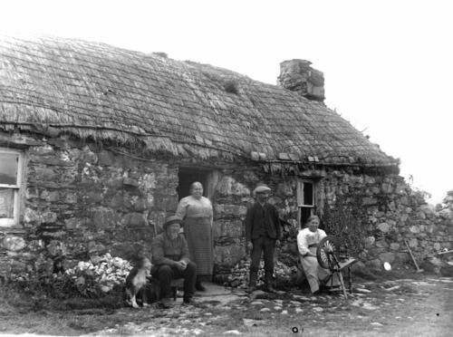 Mr Graham and his family outside Old Ulva thatched cottage, Loch Sween.