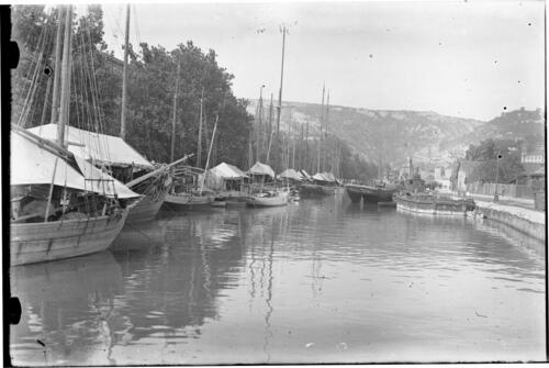 Boats moored in a canal.