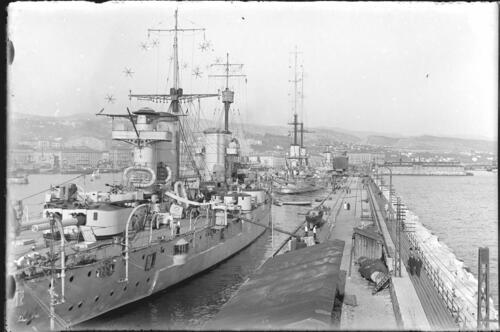 Battleships moored in [Italian] harbour.