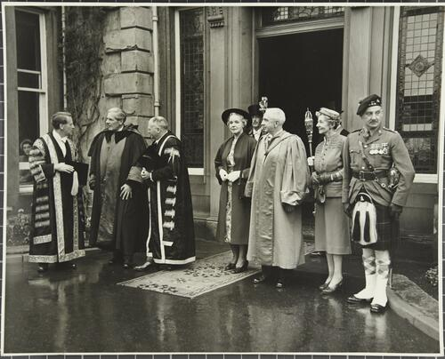 The Chancellor, the Rector and the Principal stand at the entrance of College Hall