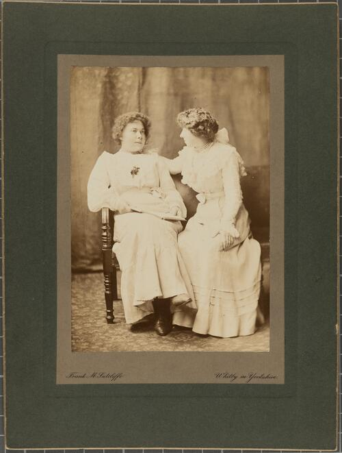 [Two women sitting on chairs]