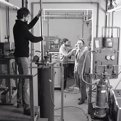 Professors and researchers working with equipment in a laborary at the School of Physics, University of St Andrews, St Andrews.