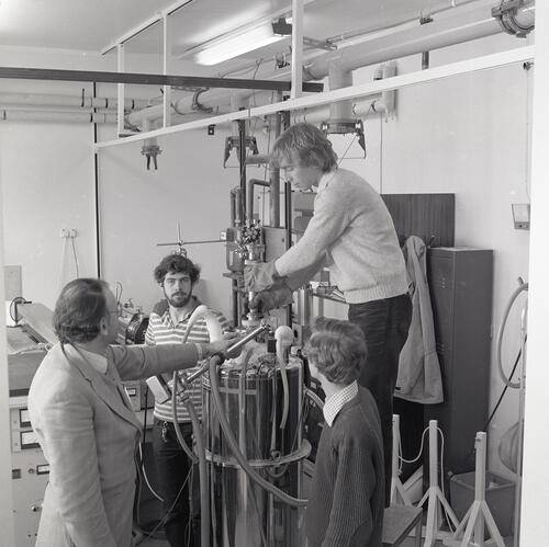 Professors and researchers working with equipment in a laboratory at the School of Physics, University of St Andrews, St Andrews.