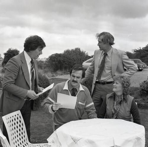 John Cleese and SRC members study the menu at The Grange Inn.