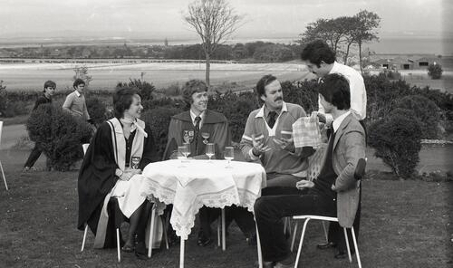 John Cleese, with SRC members, chooses a bottle of wine at The Grange Inn.