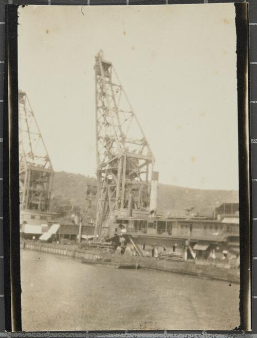 [Two large cranes in an harbour]