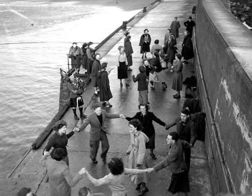 Madrigal singers and friends dancing on the Pier, St Andrews Harbour.