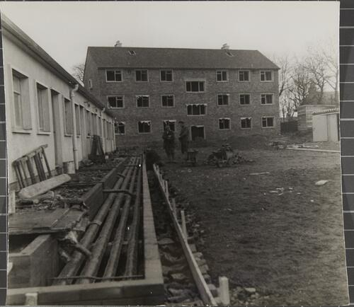 [East Kilbride - Westwood IX development, view of construction site with apartment block at the end]