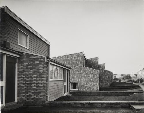 [East Kilbride, Westwood IX, side view of low rise buildings with brick walls]