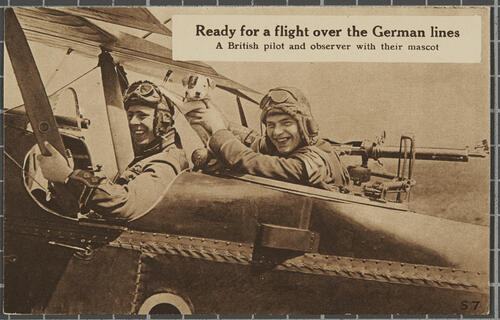 'Ready for a flight over the German lines'. A British pilot and observer with their[dog] mascot'.