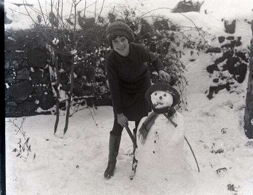 [Girl with snowman].