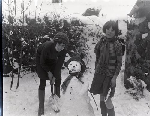 [Two girls with snowman]