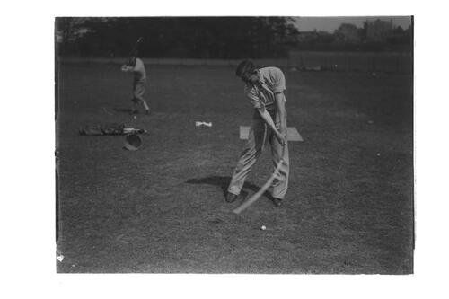 Golfers practising their swings on the Old Course, St Andrews.