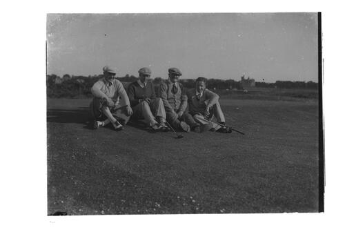 Sandy Herd and golfers sitting on the Old Course, St Andrews.