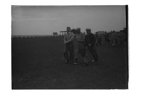 Sandy Herd, Hector Thomson and golfers walking down the 1st fairway on the Old Course, St Andrews.