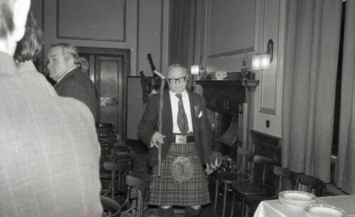 Walter Maronski (President) parades in with the president's badge of office, the 100th Celebration of the St Andrews Burns Club, at McArthur's Cafe.