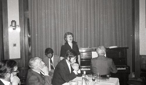 Miss Myra Brown sing Burns songs, the 100th Celebration of the St Andrews Burns Club, at McArthur's Cafe.