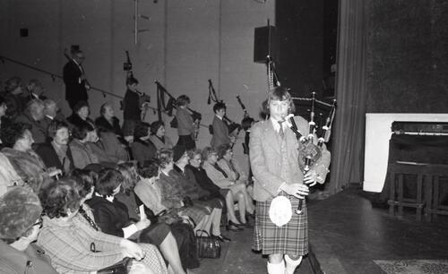 "The pipers lead in Walter Maronski (President) at John Cairney's performance of ""A Tribute to Burns"", at the Byre Theatre, St Andrews."