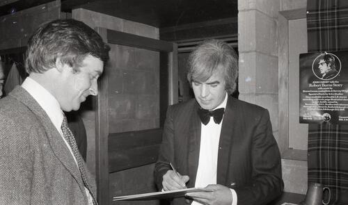 "John Cairney signs an autograph after his performance of ""A Tribute to Burns"", at the Byre Theatre, St Andrews."