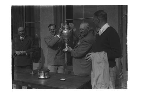 Hector Thomson being presented with the Amateur Golf Trophy, outside the R&A, St Andrews.