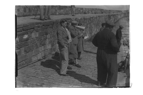 Hector Thomson and other golfers standing on the quay, St Andrews Harbour