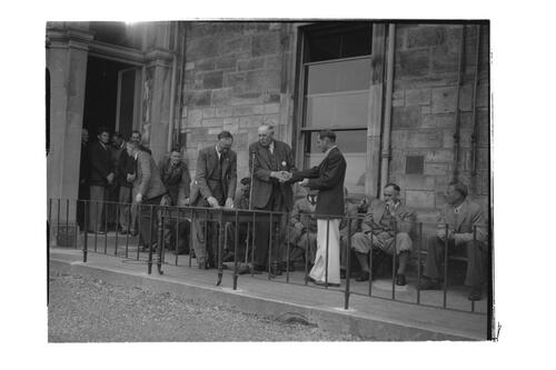 N Von Nida receives a golfing award outside the Royal and Ancient Golf Clubhouse, St Andrews.