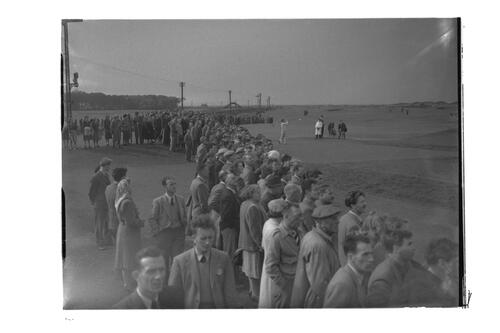 N Von Nida tees off watched by crowd, [?the 17th Road Hole Tee,] the Old Course, St Andrews.