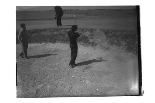N Von Nida plays out of a bunker, the Old Course, St Andrews.