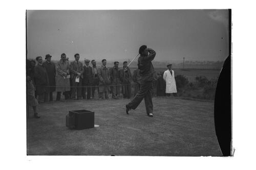 N Von Nida tees off watched by a crowd, the Old Course, St Andrews.