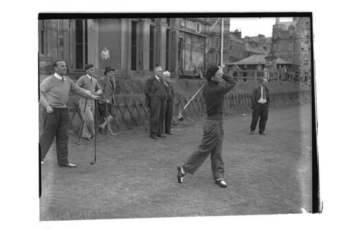 N Von Nida teeing off at the 1st Tee, watched by Adams, Shankland and Rees at the 1st Tee, the Old Course, St Andrews.