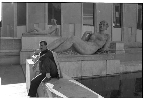 Man and nude statue