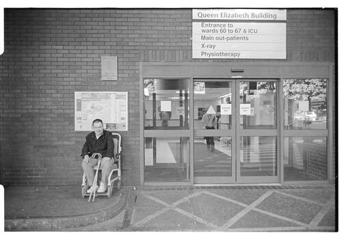 [Man in Wheelchair outside Royal Infirmary, Glasgow]