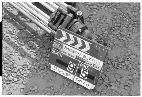 [Tripod and Clapperboard]