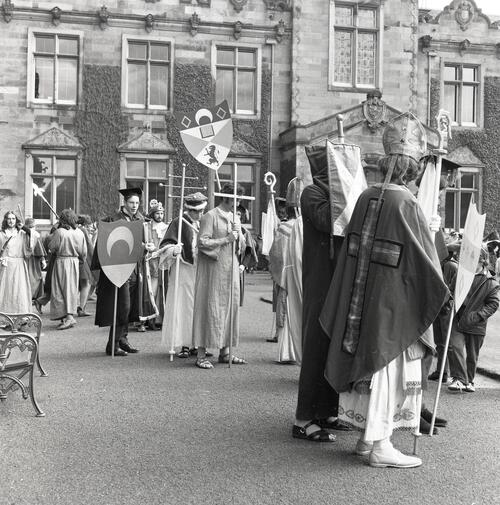 Participants in the Kate Kennedy procession assembling in St Salvators Quadrangle, University of St Andrews, St Andrews.