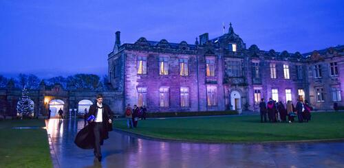University of St Andrews Graduate in St Salvator's Quadrangle at night