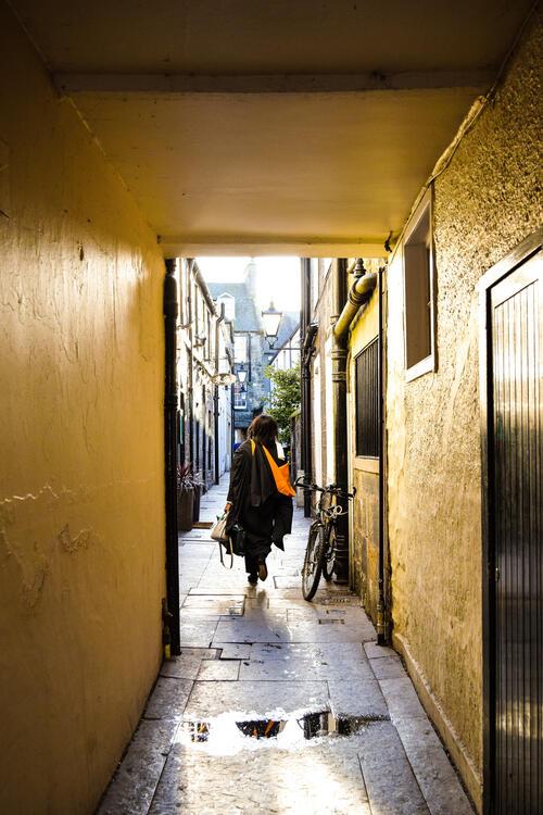 University of St Andrews Graduate walking through town
