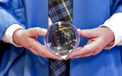 Lensball being held by Graduate in national dress at the University of St Andrews