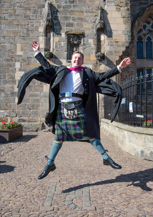 Graduate dressed in full kilt dress after Graduating from the University of St Andrews